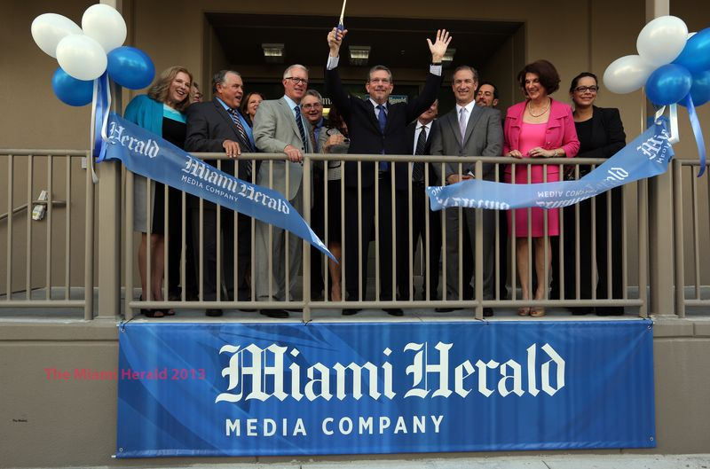 Herald ribbon cutting w watermark